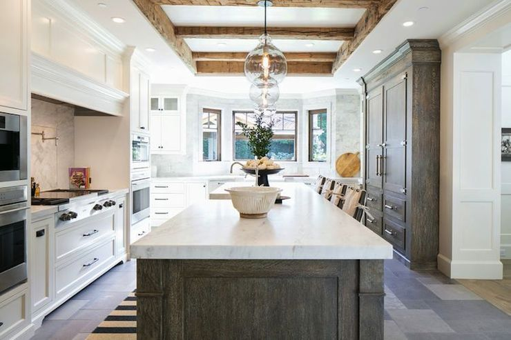 White And Gray Kitchen Boasts Rustic Wood Plank Tray Ceiling Accented With Clear Glass Pendants Over Gray Timeless Kitchen Kitchen Remodel Kitchen Inspirations
