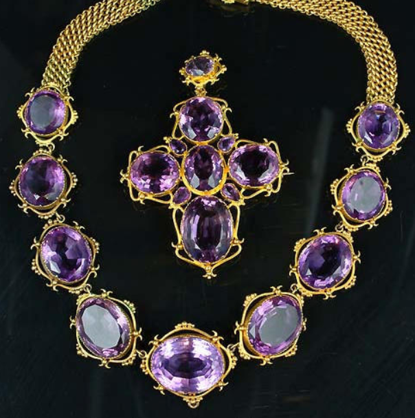An early 19th century Royal presentation amethyst and gold demi-parure, circa 1830, FOOTNOTES Accompanied by a note inscribed 'this set of amethysts was given to me by Queen Adelaide on the occasion of my being one of her train bearers at the coronation, 1830'.