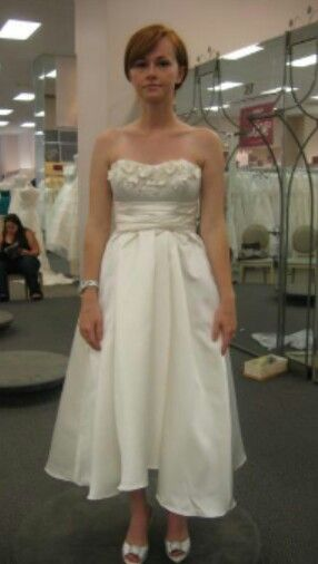 The dress is so sweet, the girl could stand up straight and smile... jesus...