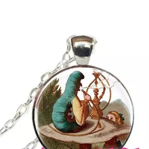 ALICE IN WONDERLAND Silver tone. Alloy glass about 20 inches. Medallion about an inch. Jewelry Necklaces