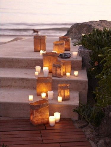simple luminaries using brown paper bags filled with sand (or kitty litter if u have no sand)....1 votive holder (glass) & a votive in any color & fragrance...lit at sunset...........so lovely....