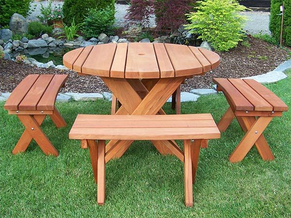round old growth redwood table set with 4 curved benches