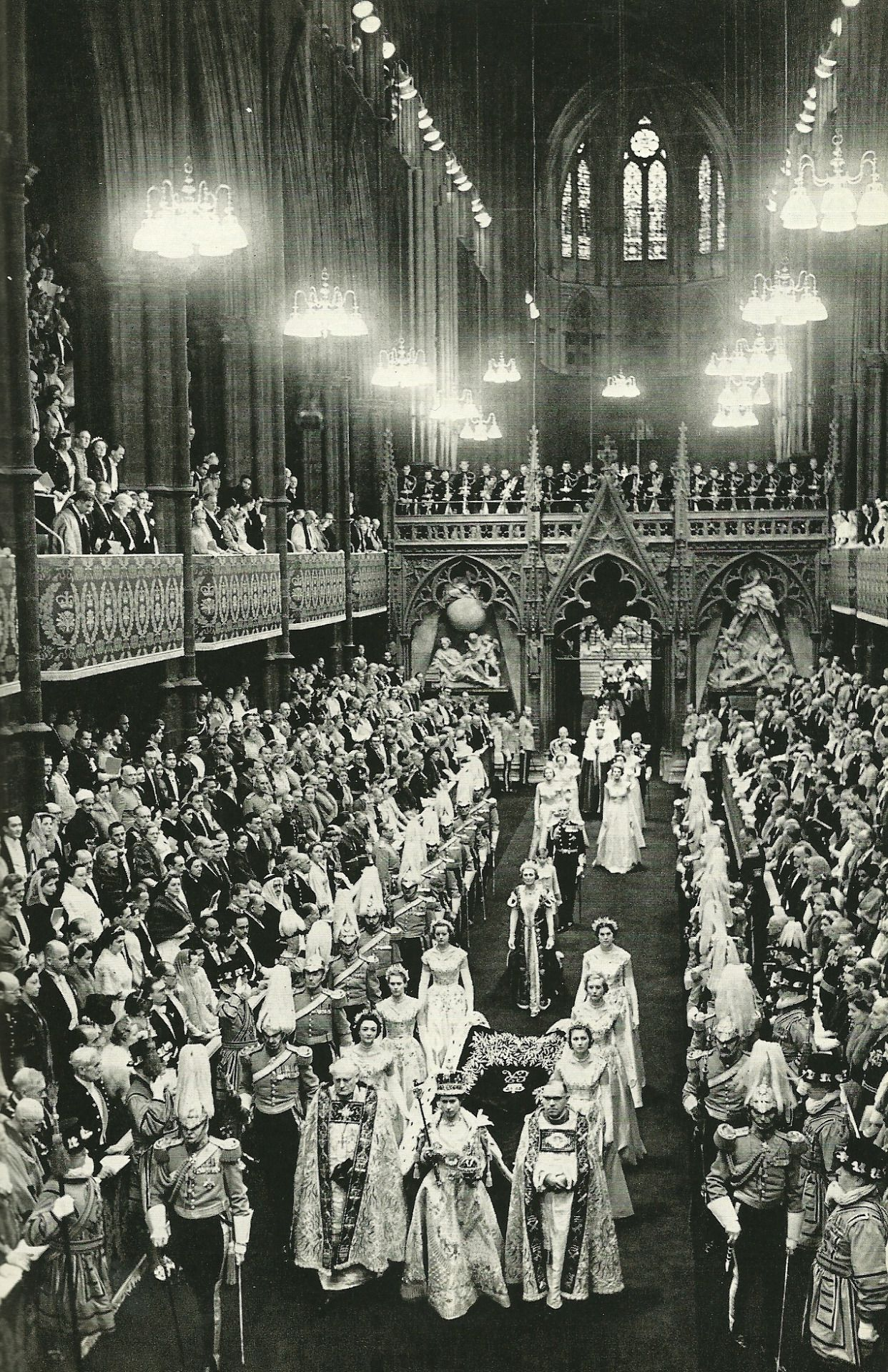 Queen Elizabeth leaves Westminster Abbey with scepter and orb in hand National Geographic | September 1953