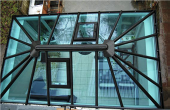Glass roof conservatory image, blue tinted glass roof conservatory