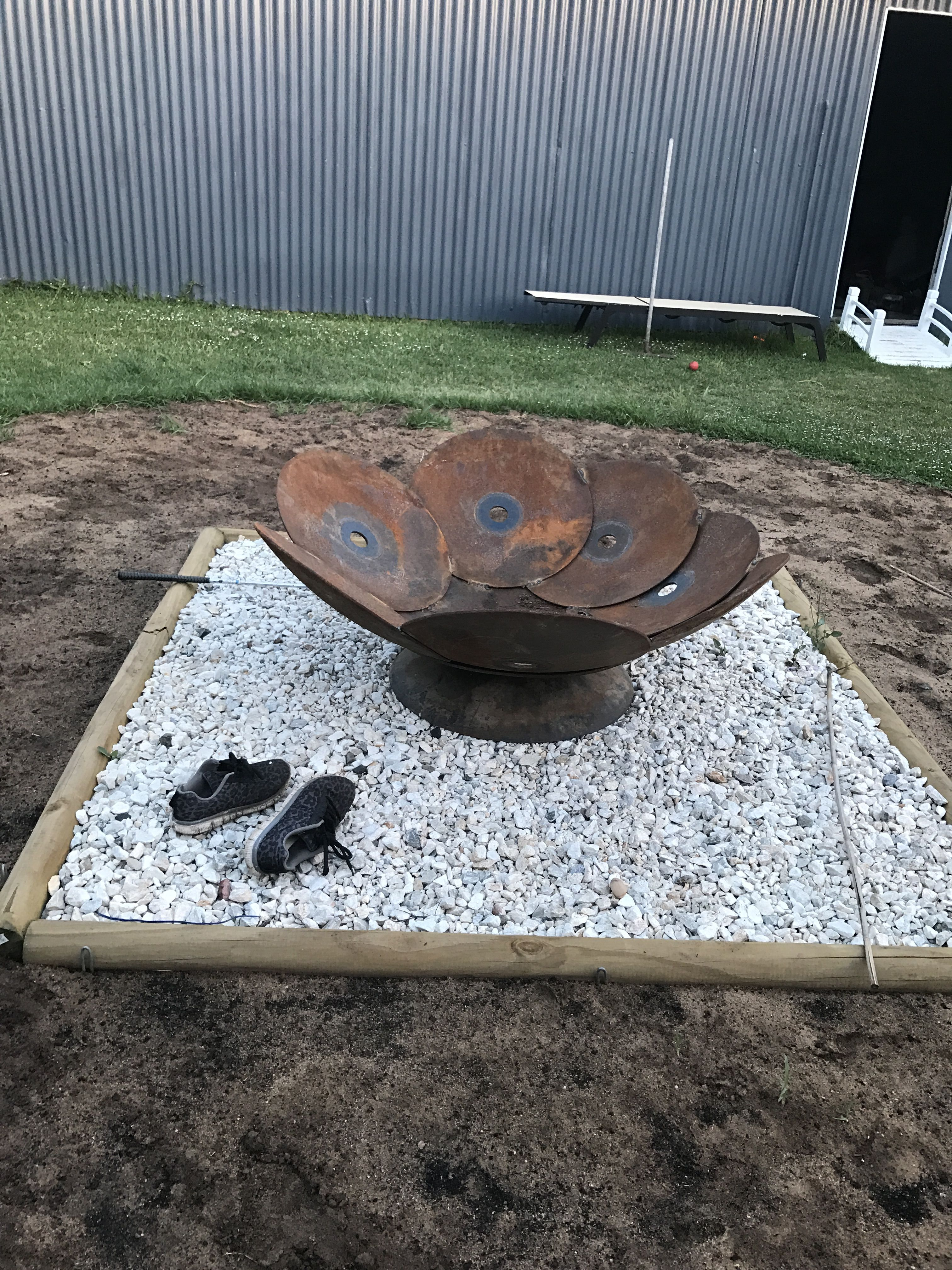 Fire pit flower made from plow discs welded together by a for Flower fire pit