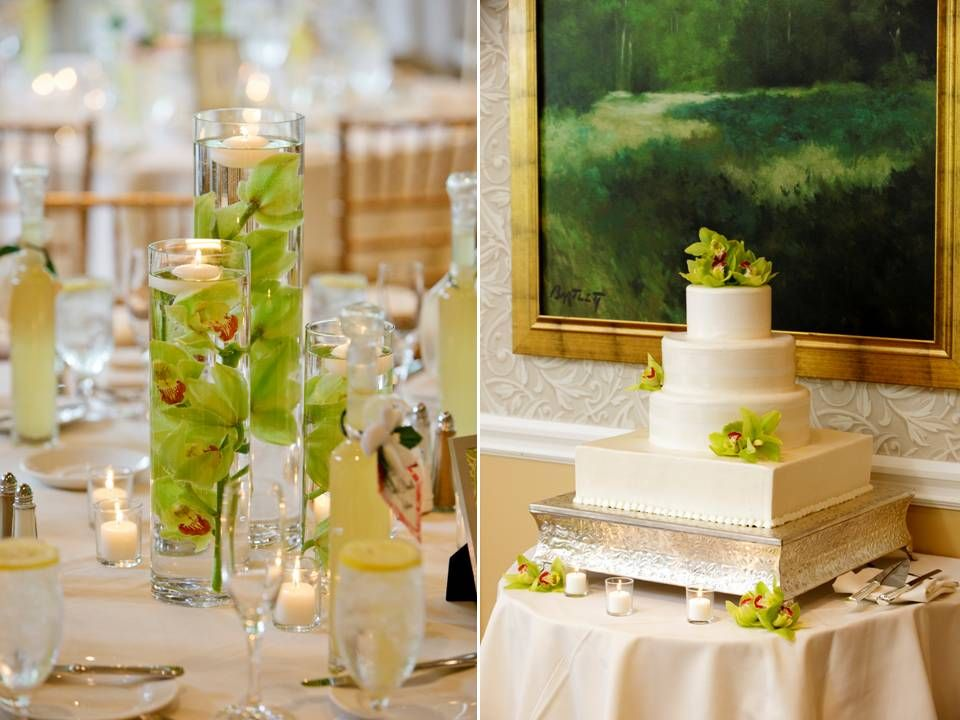 Vibrant Green Orchids Float In Clear Hurricane Vase Ivory Wedding Cake Adorned With Fresh