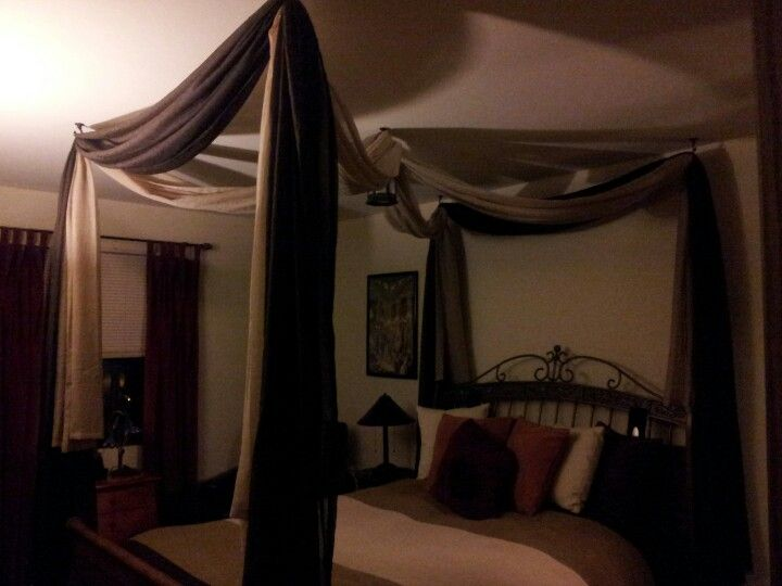 A DIY of a canopy bed. Use planter hooks on the ceiling curtain rod rings on the hooks and curtain swags strung through the rings. & A DIY of a canopy bed I recently did in my bedroom..planter hooks ...