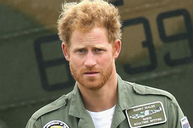 Prince Harry Debuts a Full Gin...