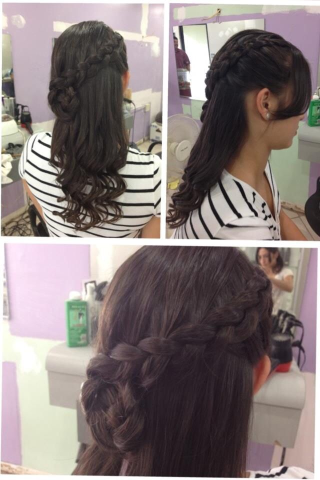 Lace braid ending in a flower. Soft curls.