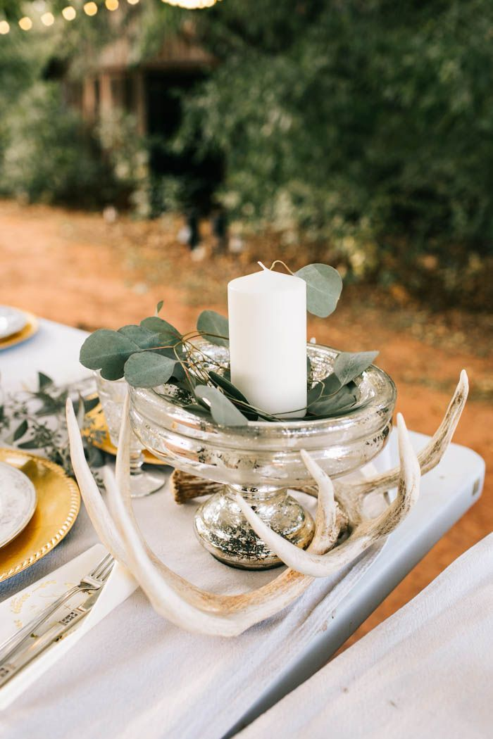 Antler accents are the perfect way to create a rustic vibe | Image by Sarah Libby Photography