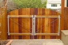 tall wooden fence across driveway - Google Search