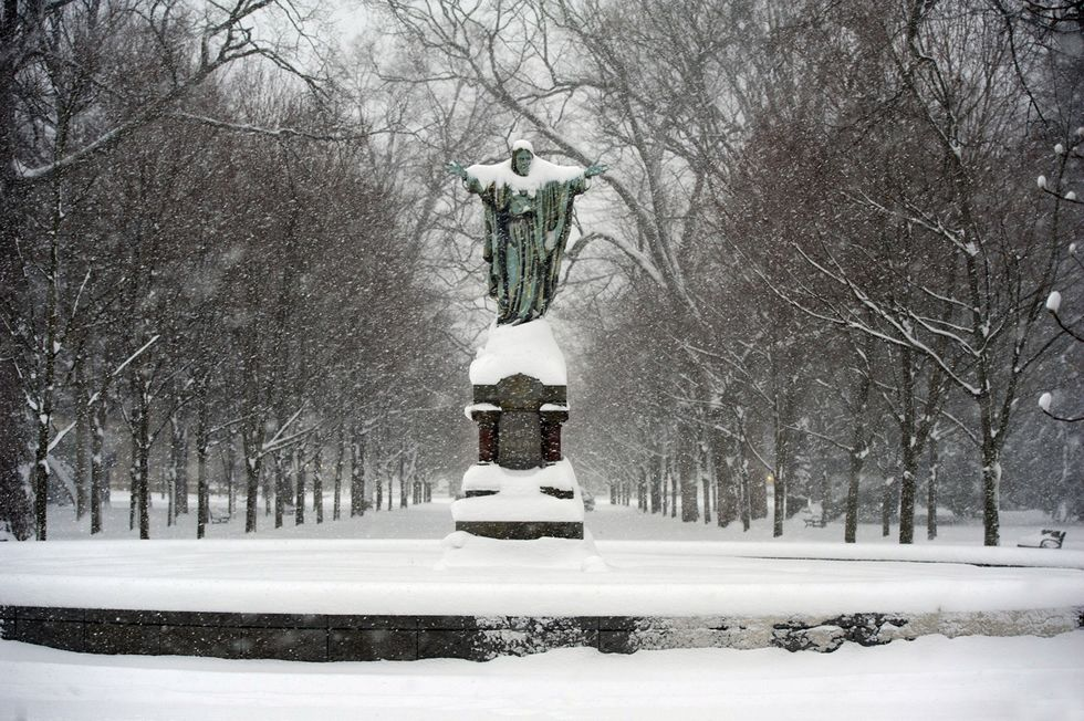 Notre Dame Sacred Heart Statute in the snow