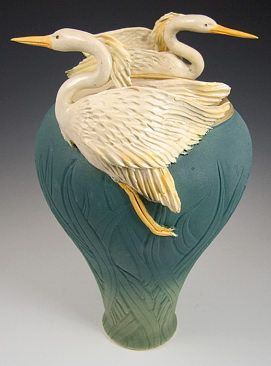 Two Flying Herons Vase.  Ceramic Herons sculpted and attached to hand formed vase with carved reeds.