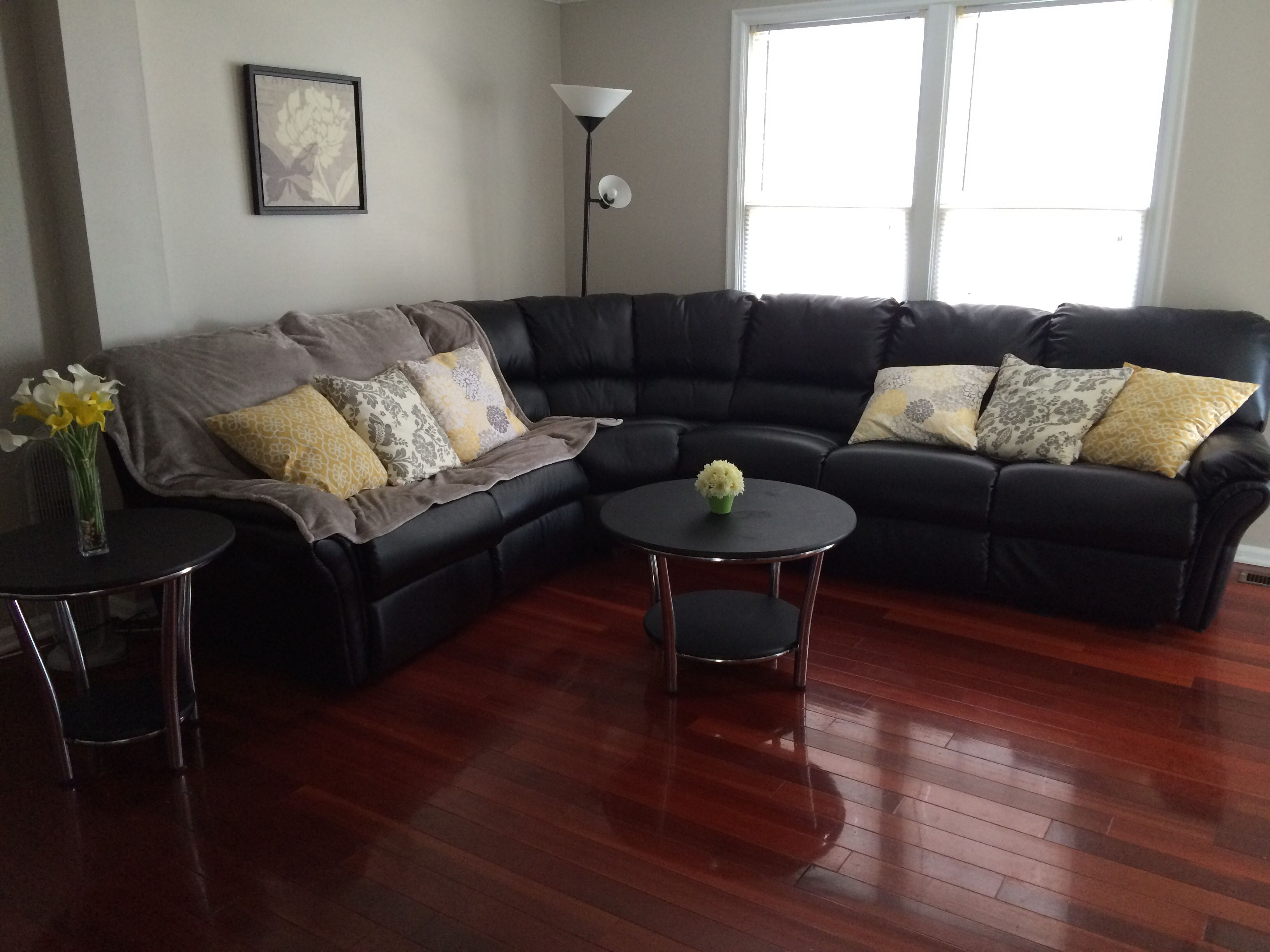 Living Room Ideas With Cherry Wood Floors Modern Sofa For Small Black Sectional Couch Yellow Throw Pillows And Hardwood