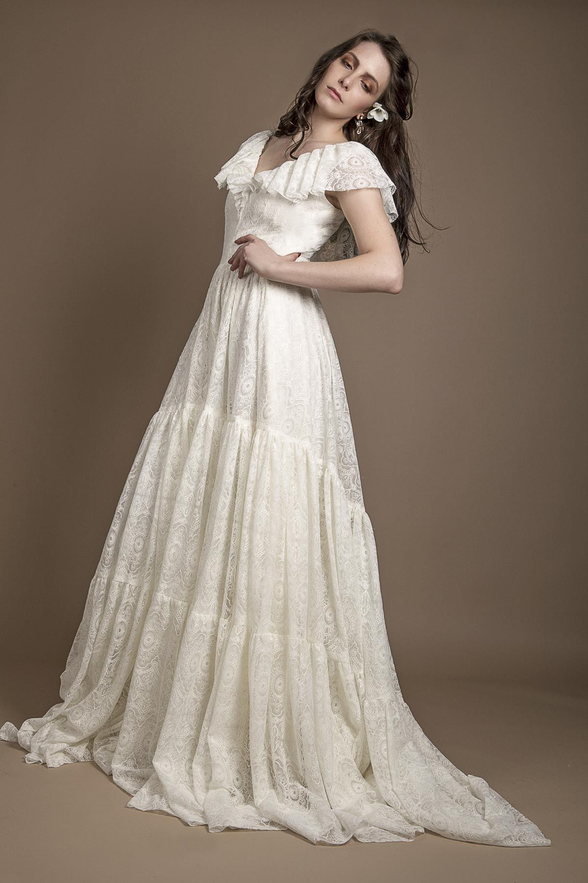 This ivory Edwardian style wedding dress in lace was designed ...