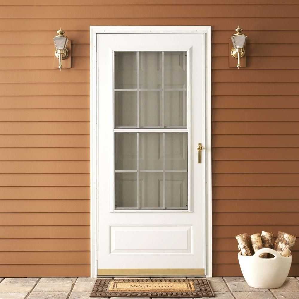 Emco 36 In X 80 In 300 Series White Universal Colonial Triple Track Aluminum Storm Door With Brass Hardware E3ctt36wh The Home Depot Aluminum Storm Doors Storm Door Glass Storm Doors