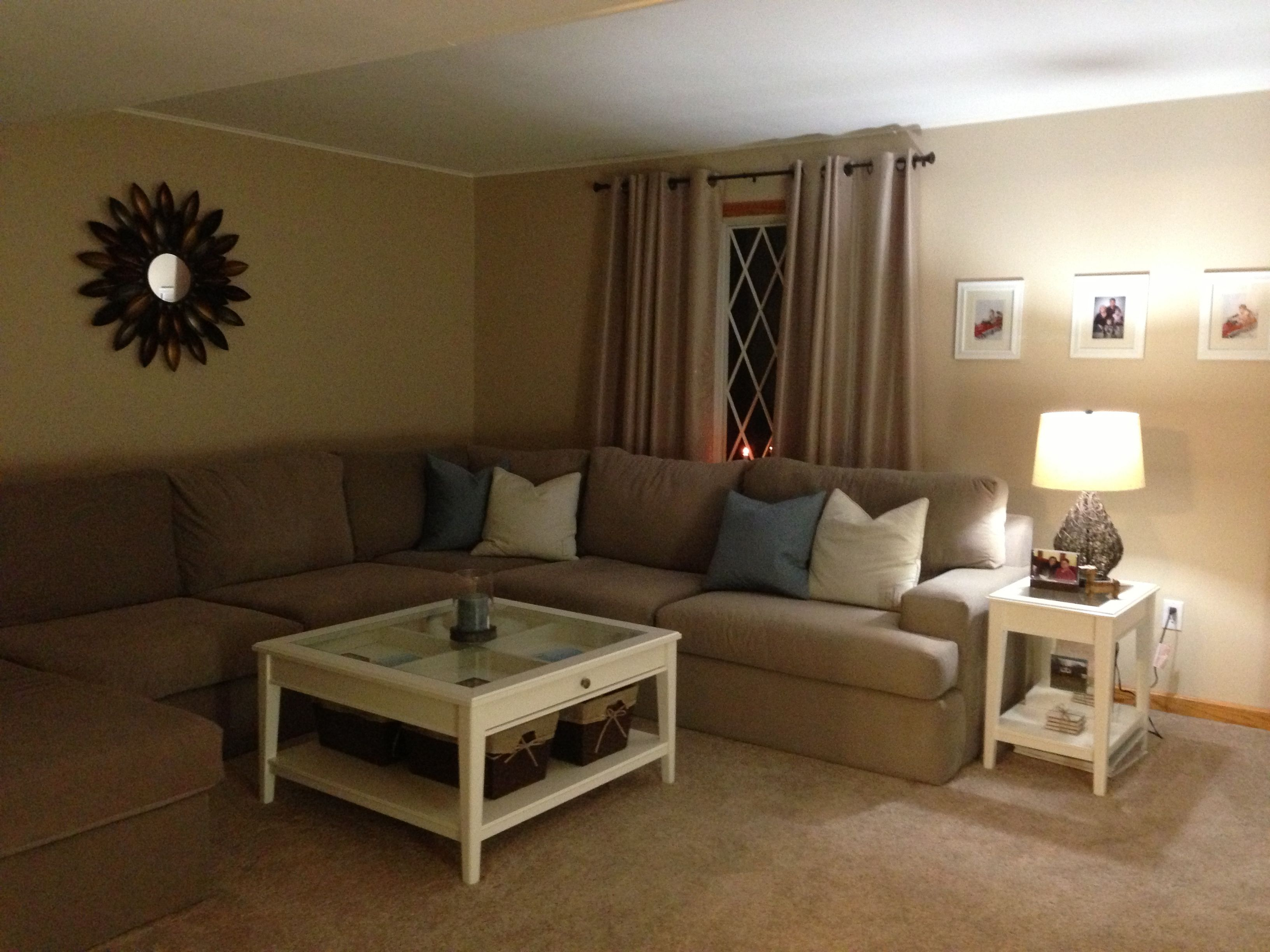 With white walls tan couch and brown carpet blue curtains Carpet for living room