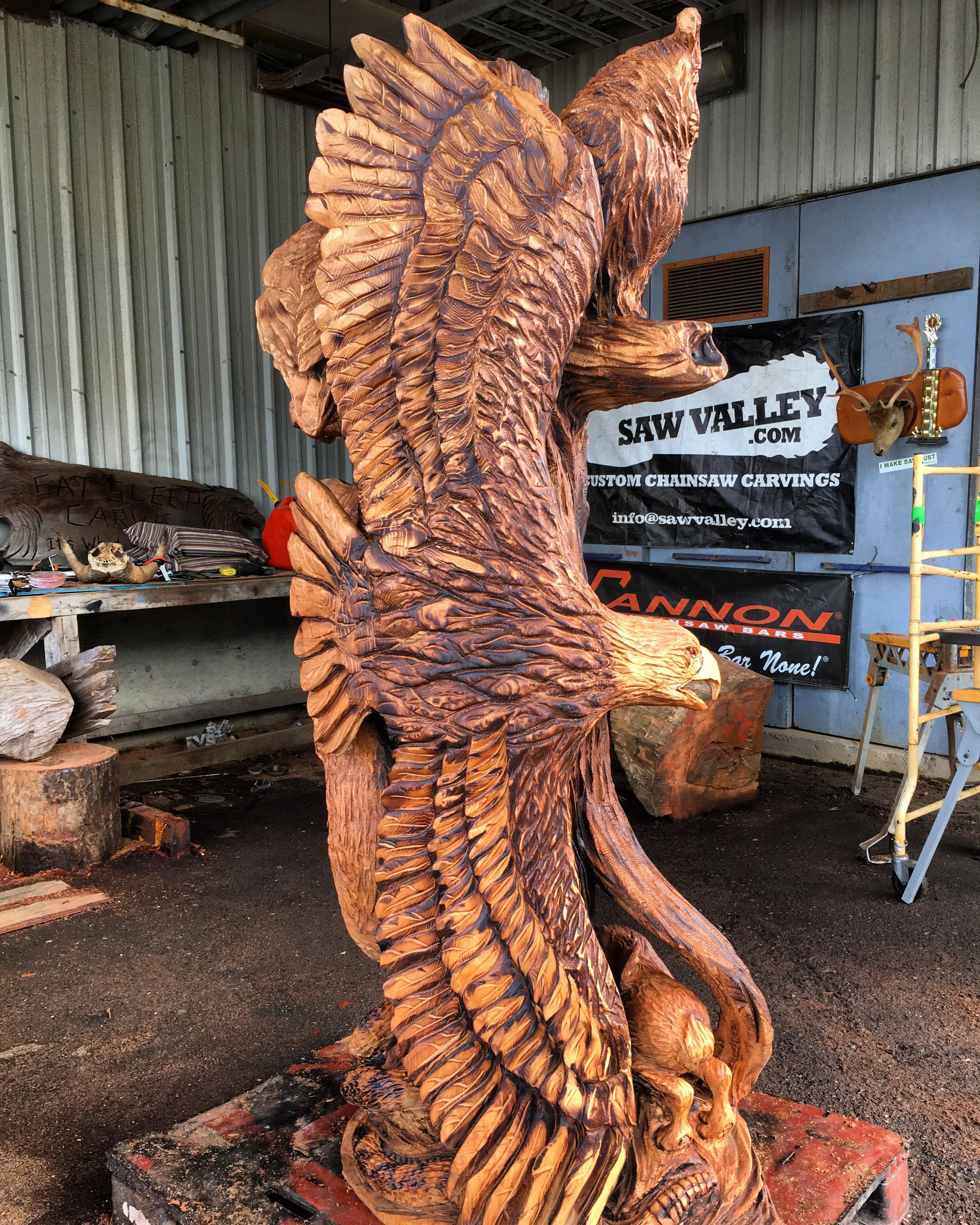 Soaring eagle looking for food chainsaw carving wood