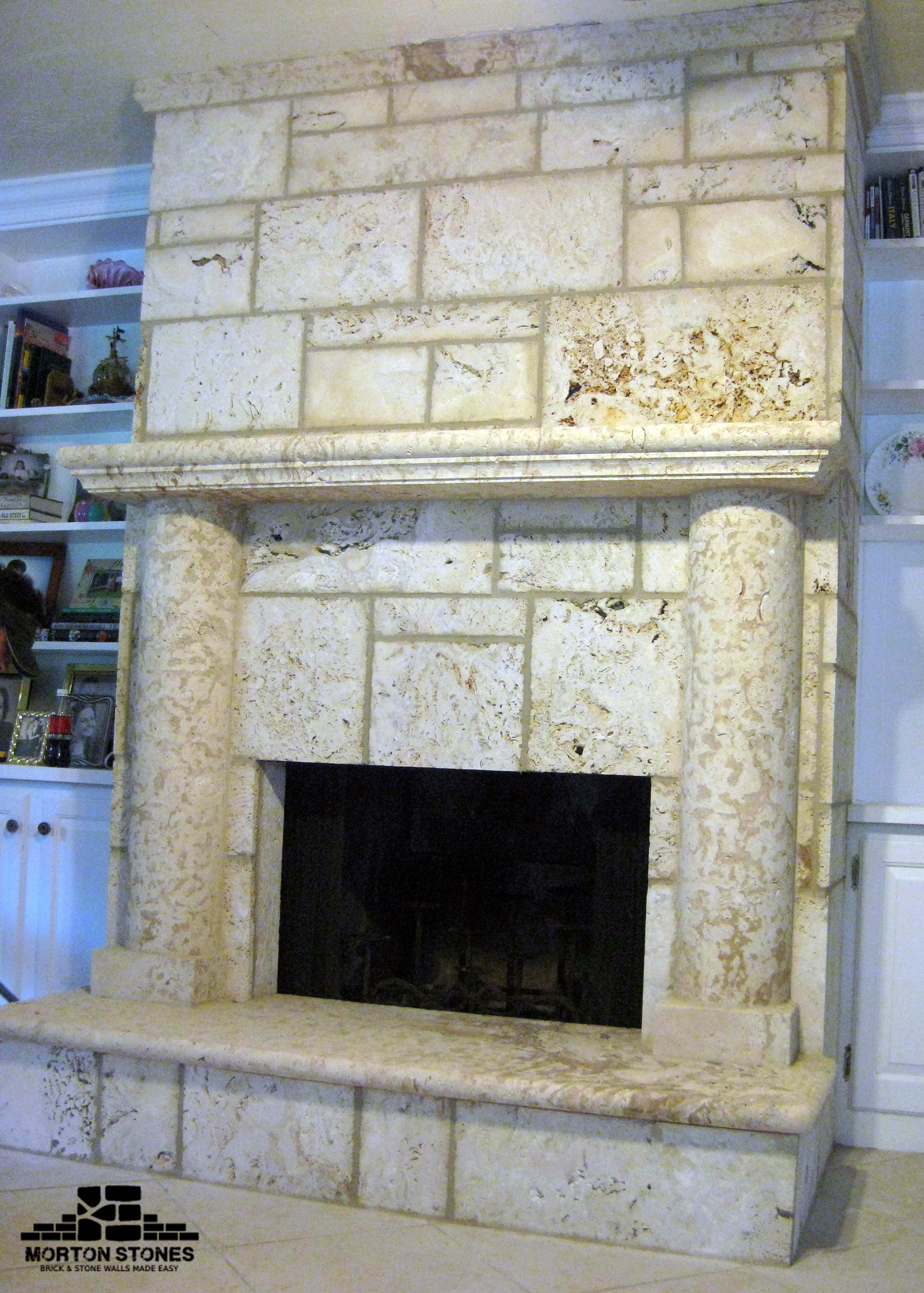 A Coral Stone Fireplace Helps Create A Welcoming Relaxing And