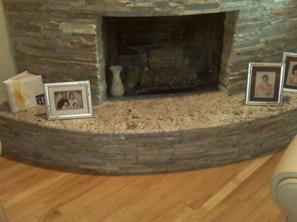 25 Fascinating Stacked Stone Fireplace Designs Slodive Curved Fireplace Granite Hearth Stone Tile Fireplace