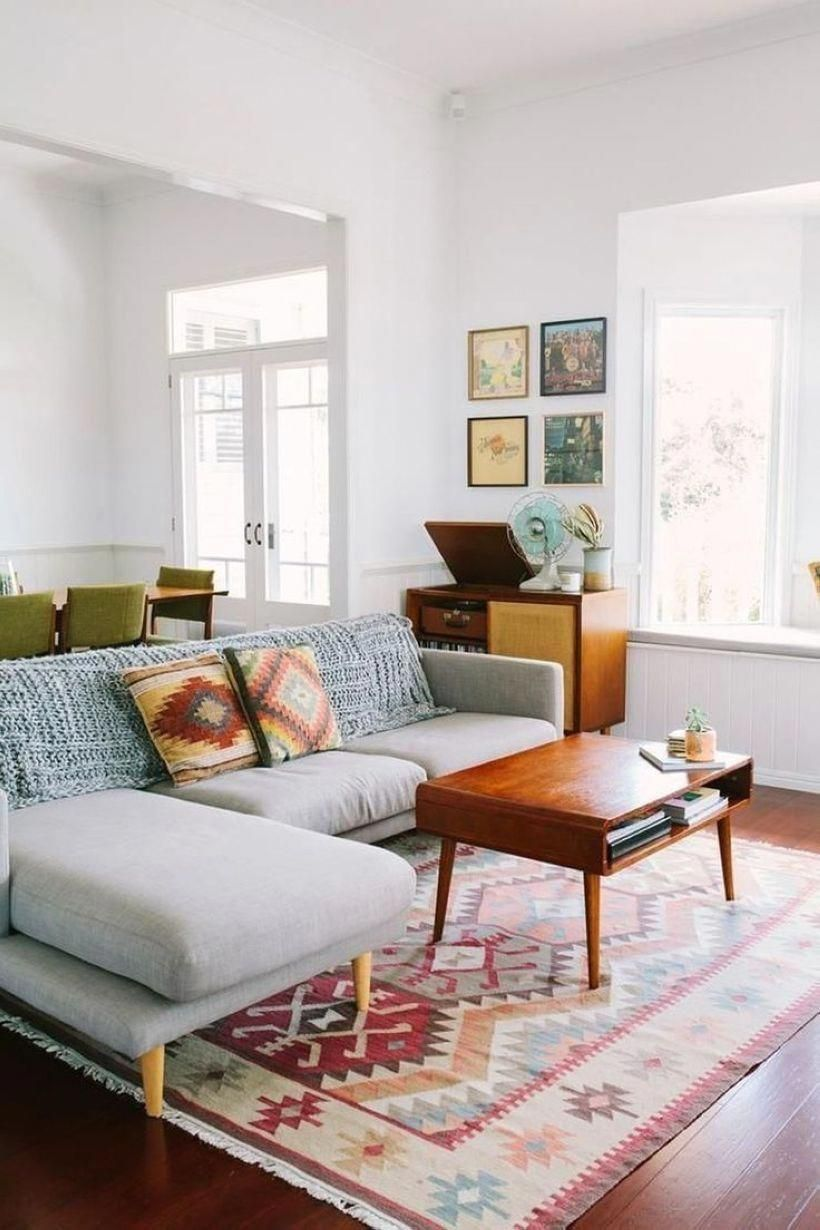 Mid century modern living room inspired by the 9s with browns
