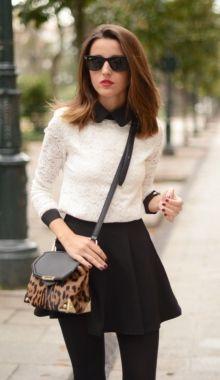 A white sweater + black skirt + leopard print crossbody bag