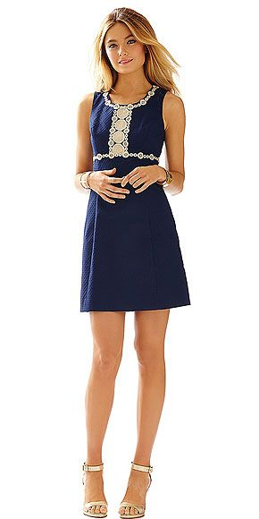 """the mod '60s vibe I'm envisioning, something with major retro appeal, like a shift dress and ultra-teased hair, is perfect. The classic gold-and-navy color combo Is not only wedding-appropriate, but it is also one of those rare looks that will work well for events that don't involve """"I Dos."""""""