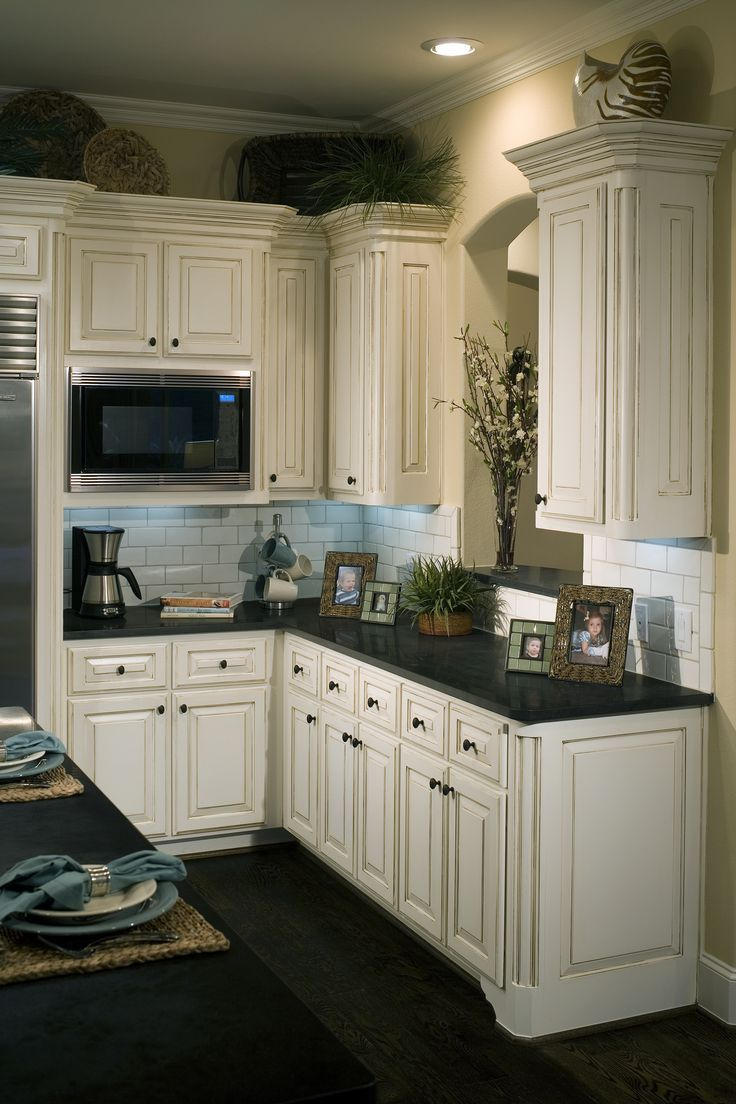 Love The Distressed Look Of These Cabinets Antique White Kitchen Dark Kitchen Floors Antique White Kitchen Cabinets