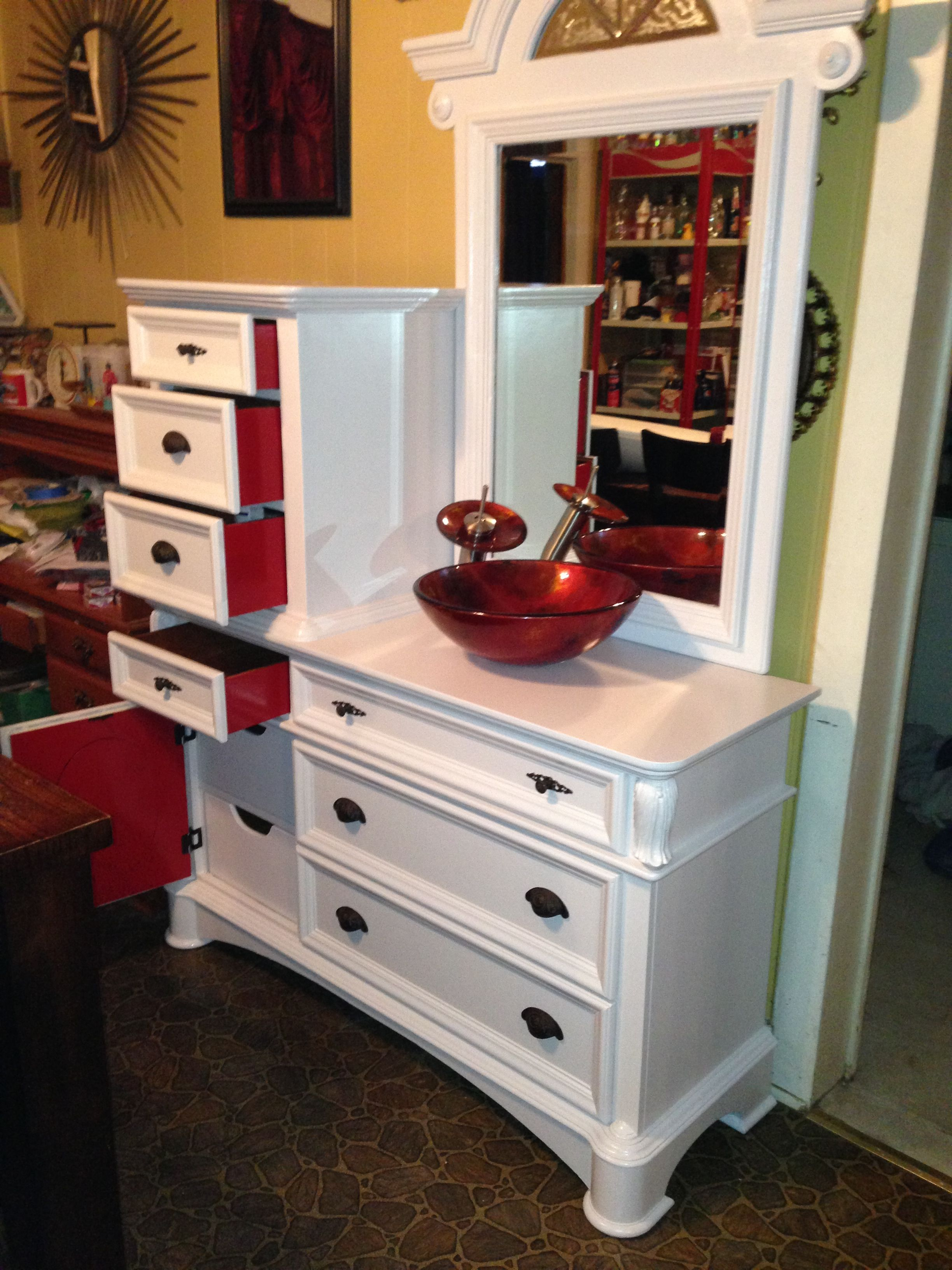 Painted and ready to go. Antique dresser made into a vanity for our new bathroom. Painted with marine paint.