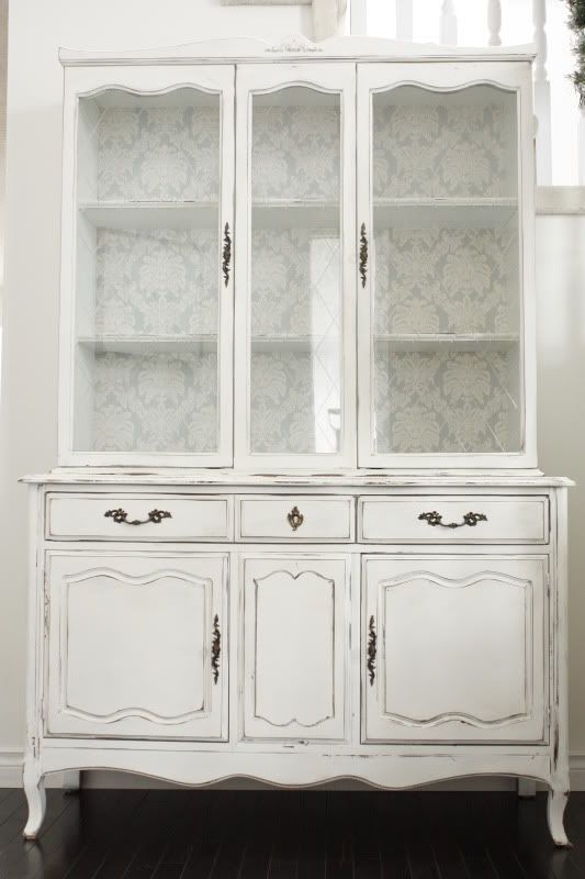 Maybe we should paint our china cabinet. The wallpaper inside is beautiful!