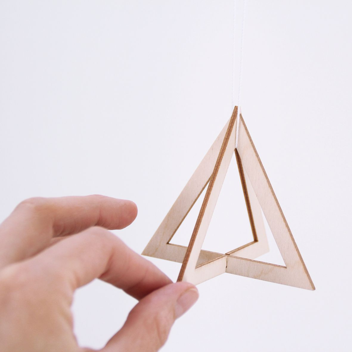 SNUG.TRIO Set of 3 wooden pendants / triangle, circle and square http://snugonline.bigcartel.com/product/snug-trio