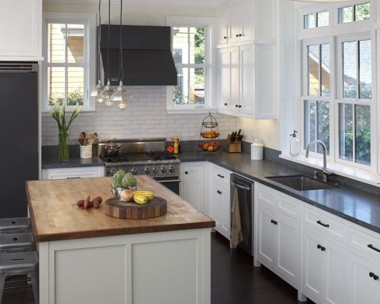 Honed Absolute Black countertops and a butcherblock island ...