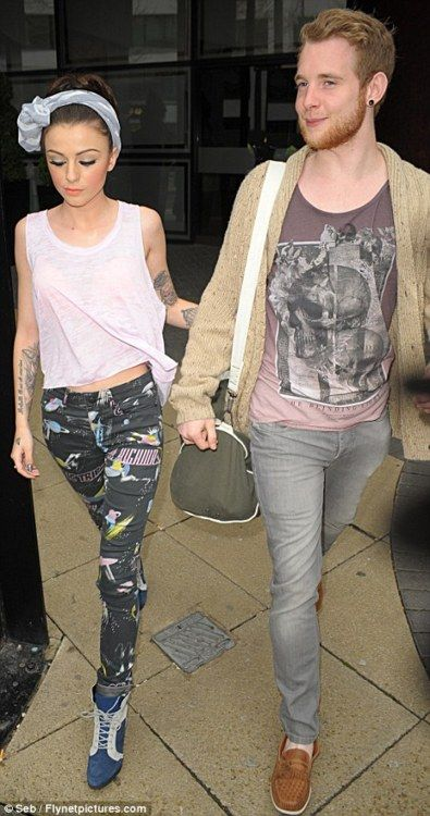 Cher Lloyd wearing what looks to be a grey skull print scarf as a headscarf.