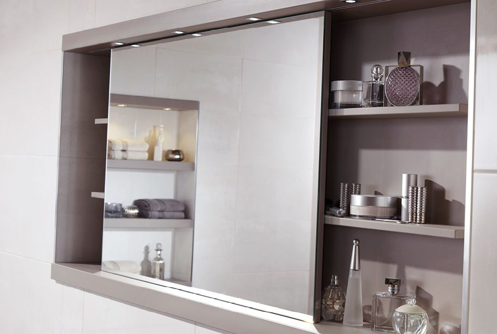 Sliding mirror with feature shelving and concealed