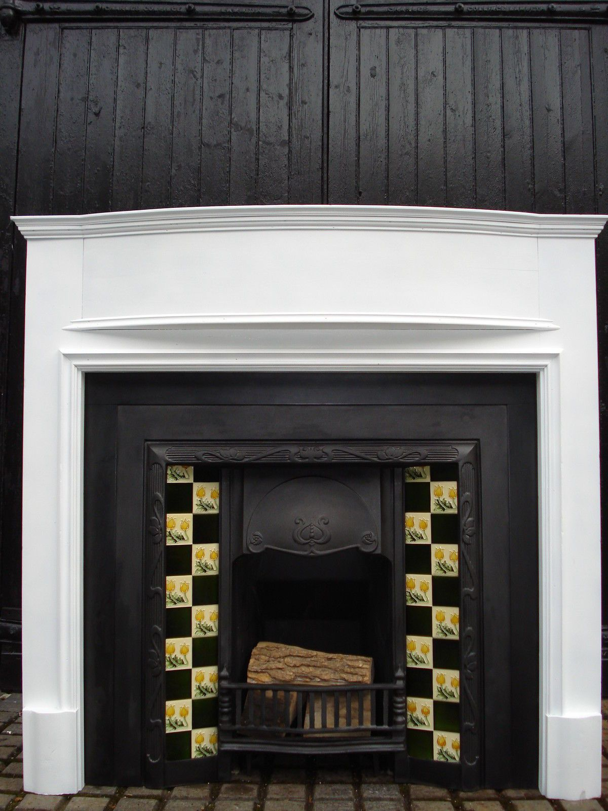 like this surround with a non tiled cast iron insert fireplace