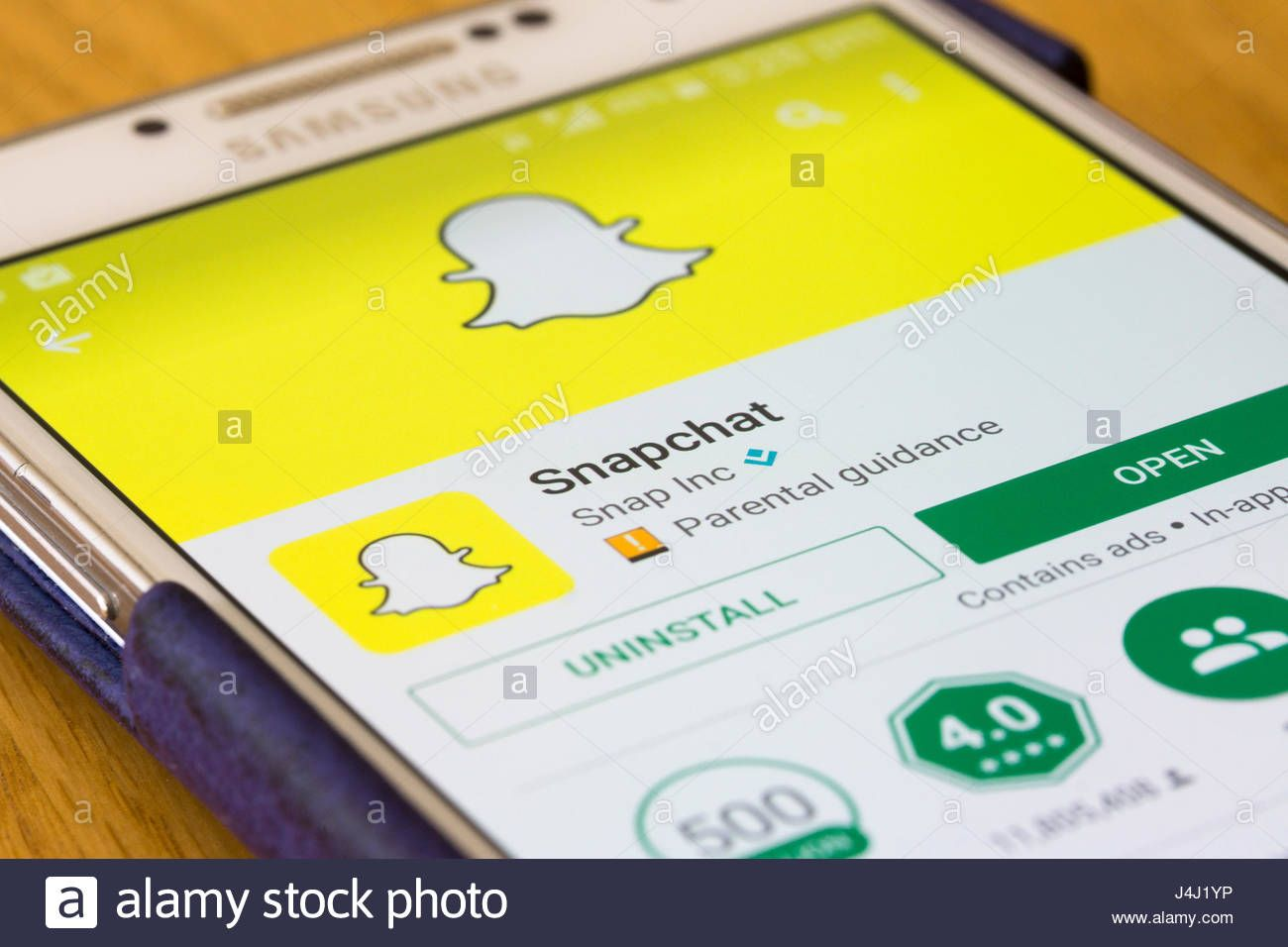 Download this stock image A closeup on the Snapchat app