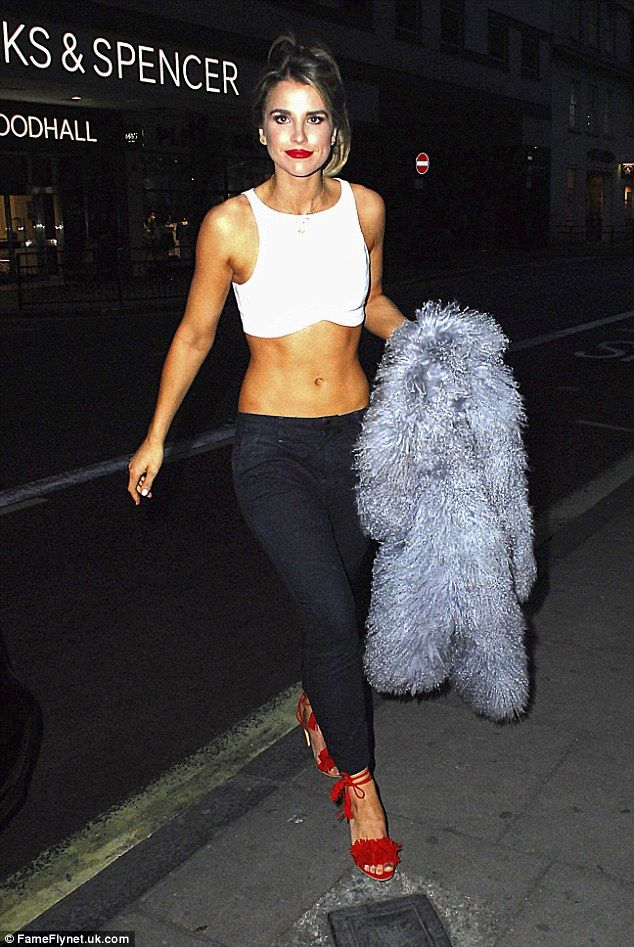 Model figure: Vogue Williams showcased the results of her hard work as she flaunted her taut tum at the launch of Replay's latest denim collection in London on Tuesday evening