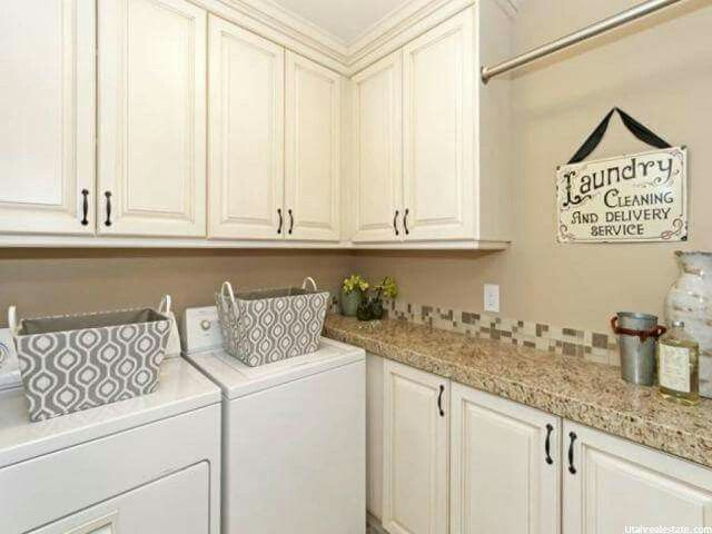 Laundry room cabinets and countertop.