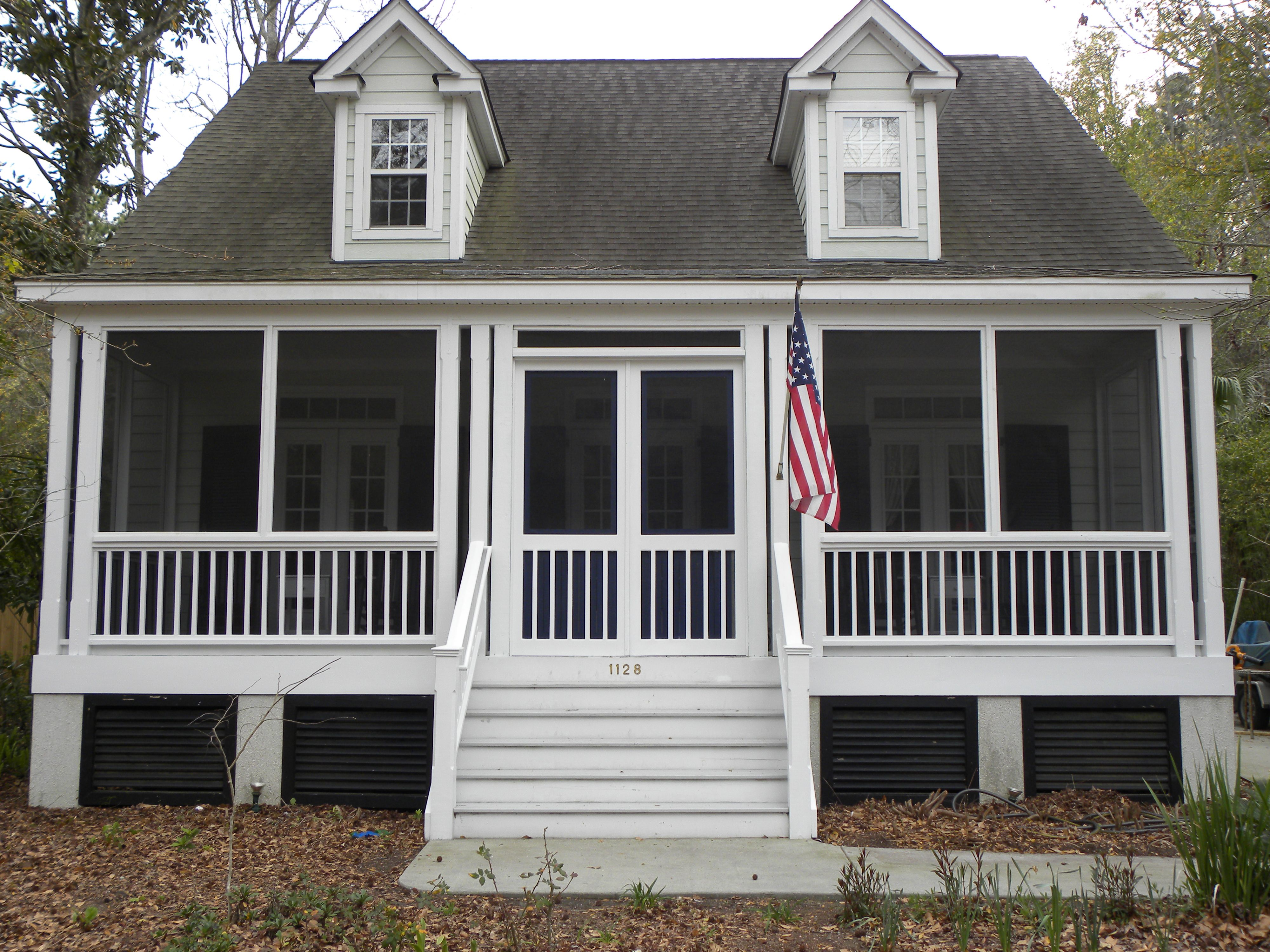 Here Is The Finished Product Screened The Front Porch Front Courtyard Enclosed Front Porches Porch Railing Designs