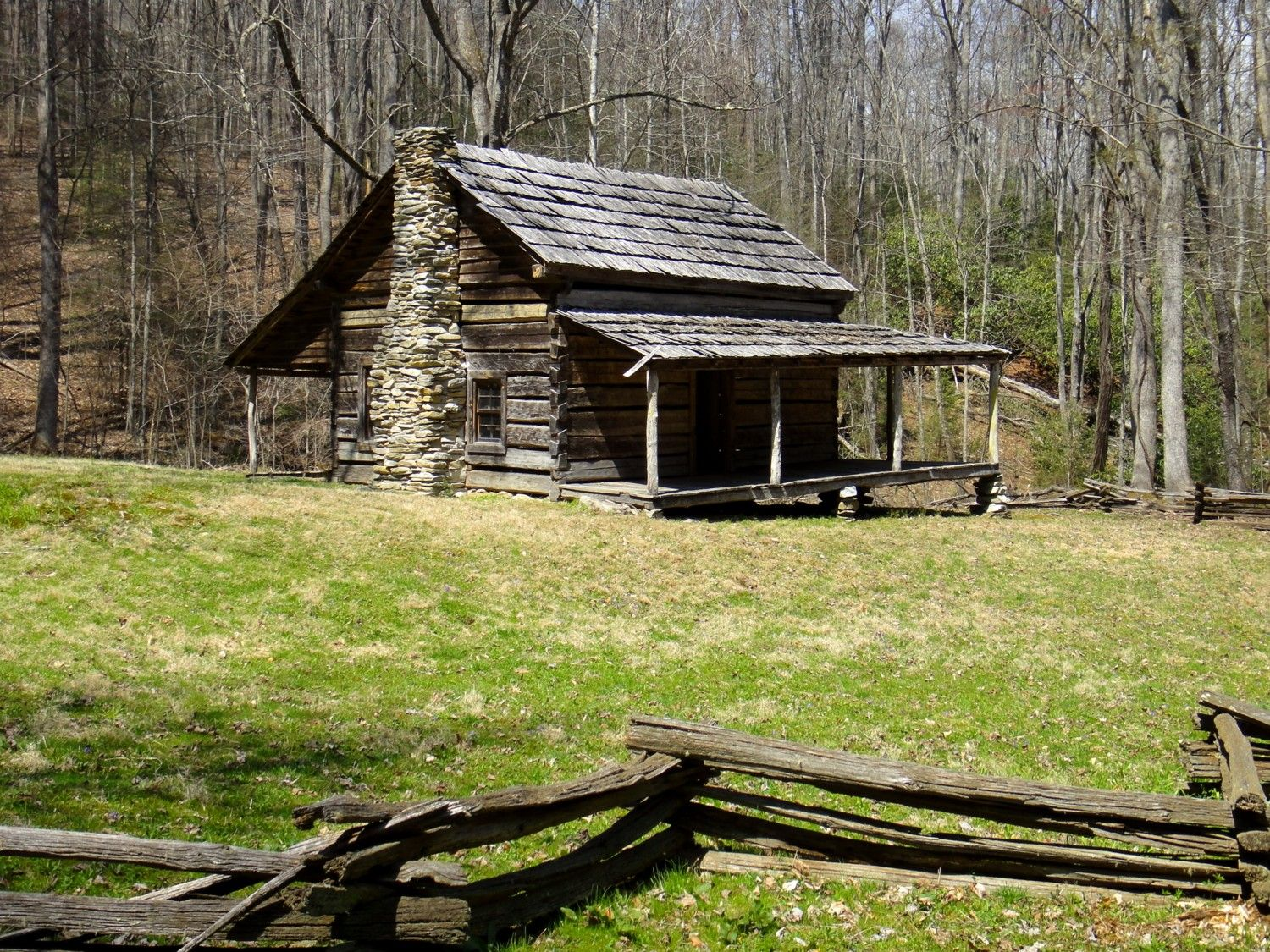 The old dug road in cataloochee cabin porch and log cabins