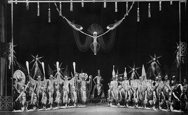 Credit: Corbis Dancers and showgirls fill the stage during a revue at Paris's Folies-Bergeres, c1920