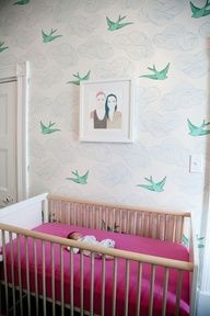 I love this nursery with a portrait painting of the parents right above the crib. So sweet. and Love the wallpaper.