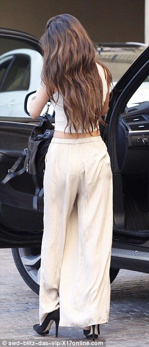 Selena Gomez flaunts black bra and tummy in a see-through cropped top