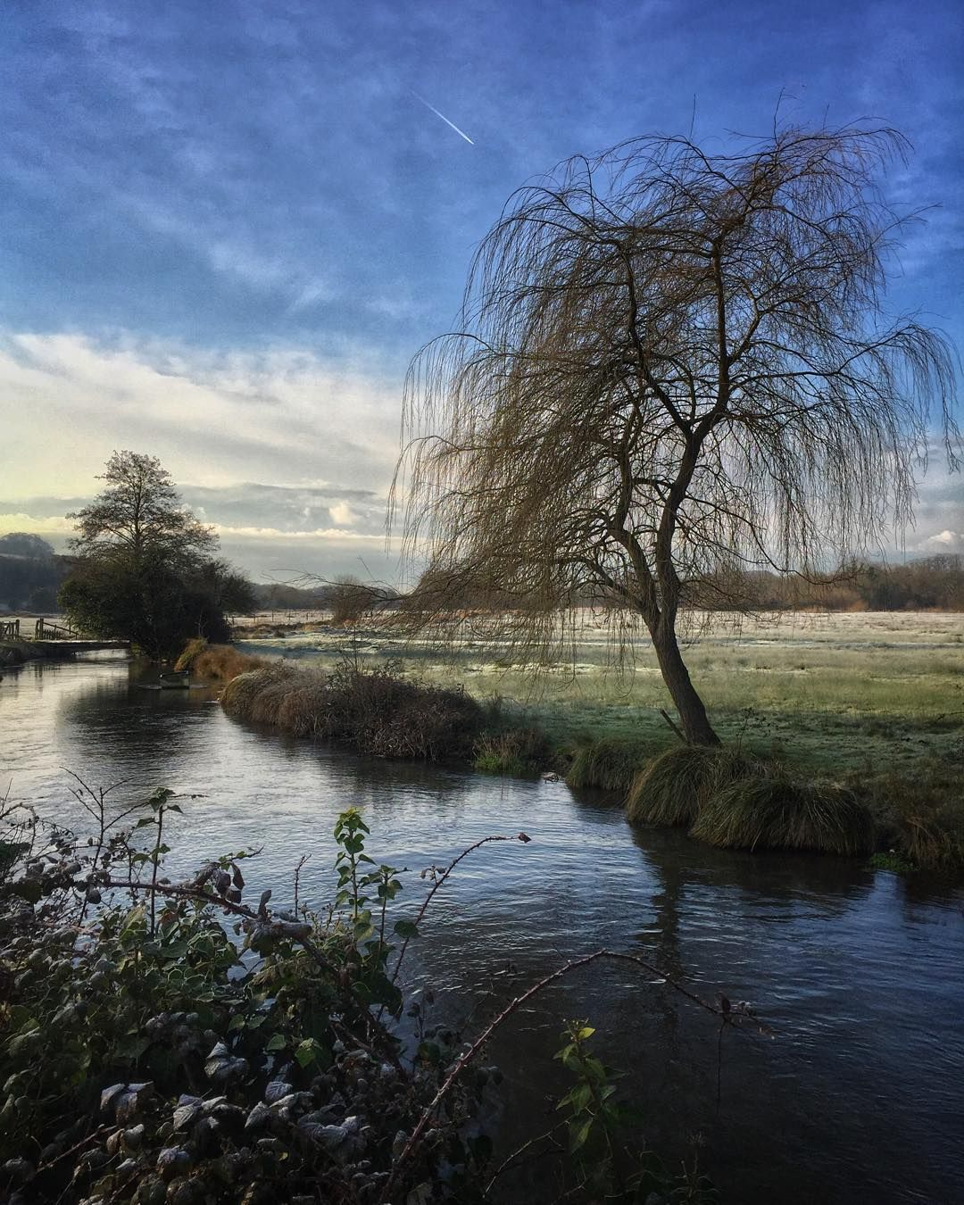 Frosty one this morning it's going to be a blue sky day. #ukcountryside #watermeadows #frost #chemtrails #itchen by johnkernickphotography