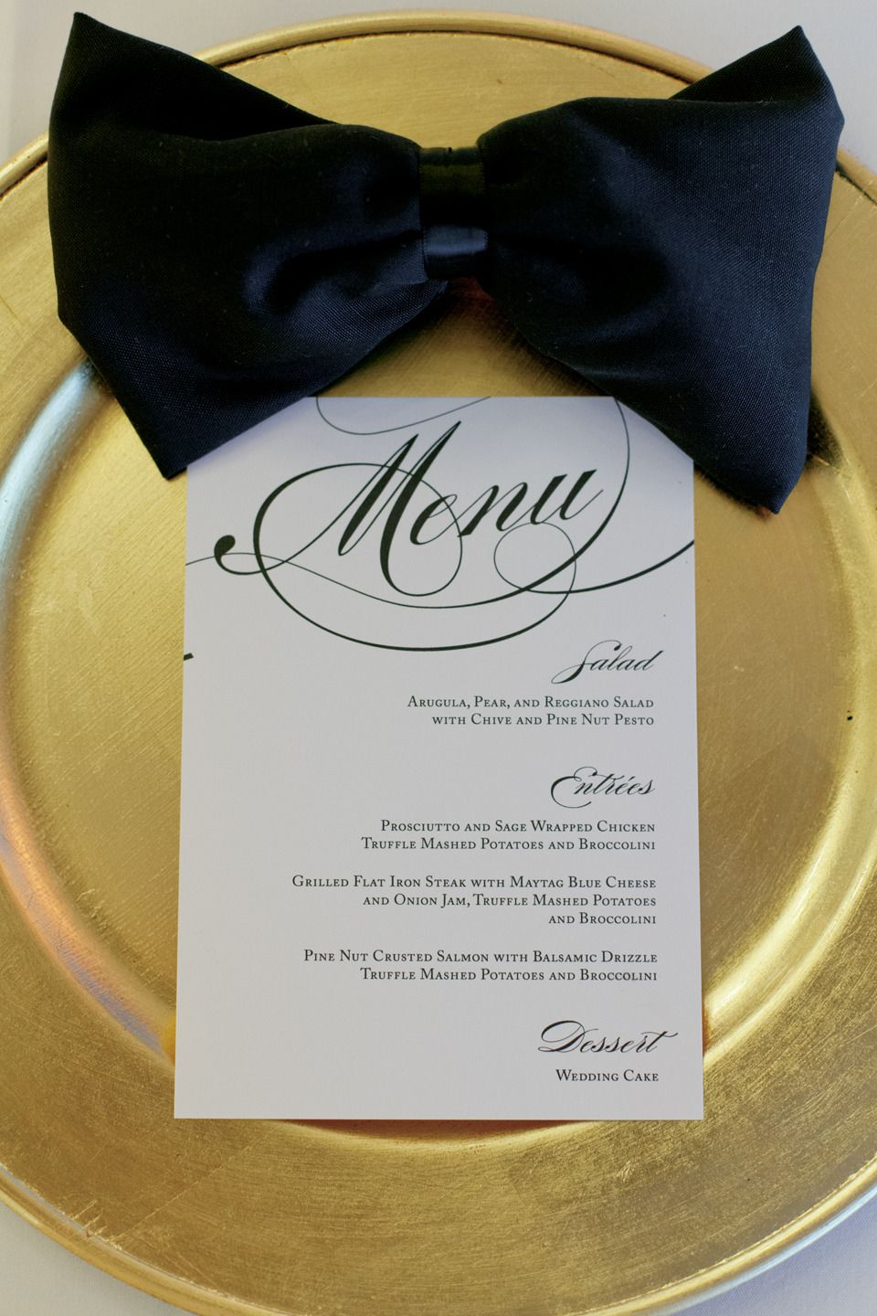 Up close photograph of wedding table/setting. I love how the napkins are in the shape of a bow tie.