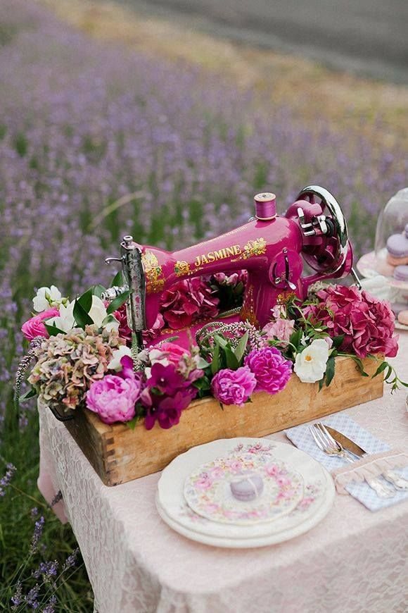 Ever consider using a vintage sewing machine for a center piece? I think this is a stunning idea for a wedding or tea party!