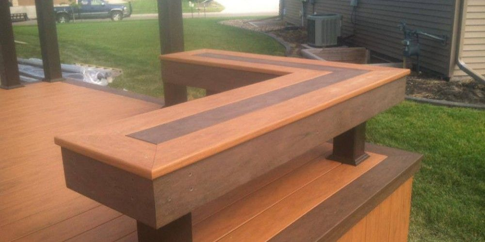 Trex decking with a hot tub inset and trex benches