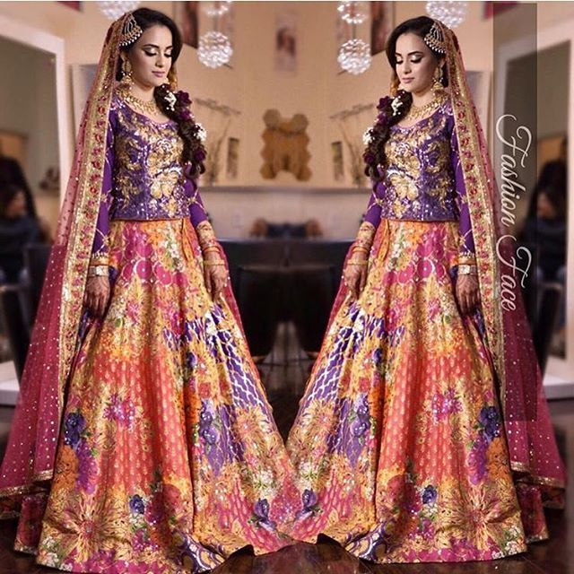 798d406857 Maliha Khan looks festive, fun and flirty in a #deep #purple and #coral  lehnga choli from our #Oudh collection at her mehndi in #houston #texas, ...
