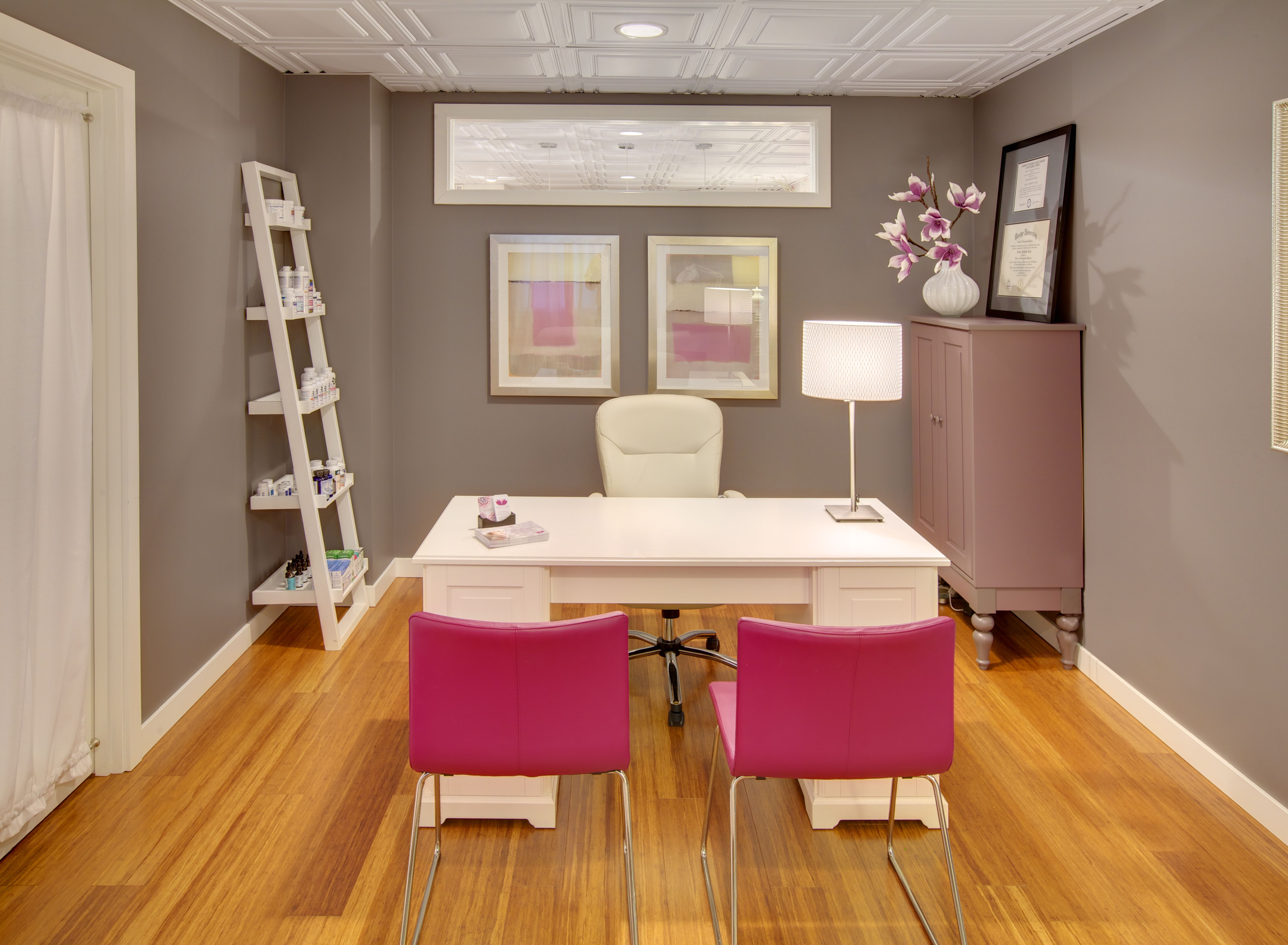 Bella Fiore Spa. The Naturopathic Doctor's office was painted the most subdued color in our palette, Granite by Benjamin Moore, but pinks and purples were brought in as accents. #grayroom #whitedesk #ikeafurniture #interiordesign #seattle