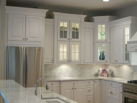 I like the mixture of solid doors and glass and the varied for Kitchen cabinets jackson
